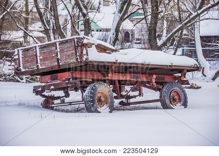 old tractor truck on wheels in the winter