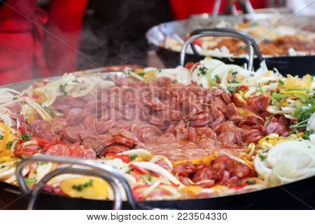 street food, hot dogs on the grill, grilled sausages on the grill