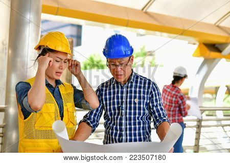 Concepts Business Engineering Stress, The engineer worked unhappily, Young Business people are tense with the job.