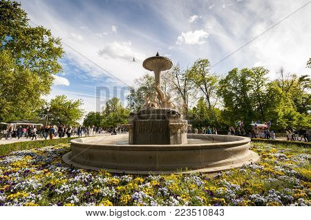 MADRID - APRIL 19, 2015: Sculptural group in the Pond turtle Fountain, Retiro Park, Madrid, Spain, on April 19, 2015. It was built in 1832, by the architect Francisco Javier de Marietegui, and sculptures by Jose Tomas