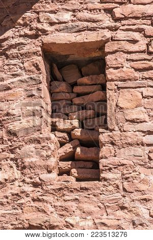 Manitou Springs, CO/USA - Circa September 2016: A window filled with bricks at the Manitou Cliff Dwelings in Manitou Springs, Colorado.