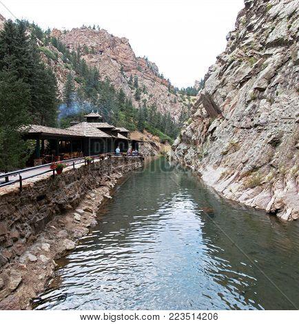 Colorado Springs, CO/USA - Circa September 2016: A view of Restaurant 1858 and the beginning of the creek at Broadmoor Seven Falls in Colorado Springs, Colorado.