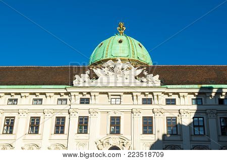 Detail bottom view of facade of the Hofburg Imperial Palace, Vienna, Austria