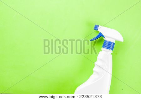 Spring cleaning concept Cleaning spray on green background copy space