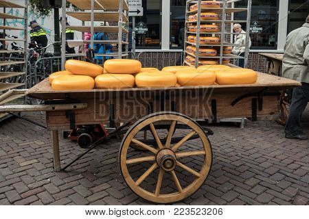 ALKMAAR, THE NETHERLANDS - APRIL 21, 2017: Typical cheese market in the city of Alkmaar in Netherlands, one of the only four traditional Dutch cheese markets still in existence and one of the country's most popular tourist attractions.