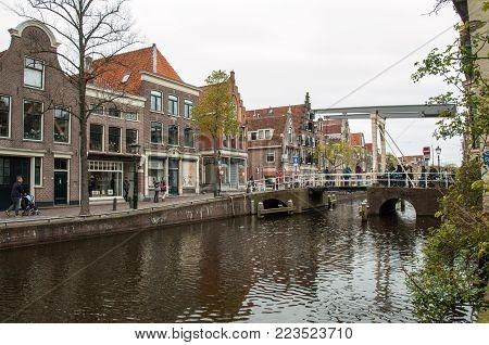 ALKMAAR,  NETHERLANDS - APRIL 21, 2017: Historic old town of Alkmaar, North Holland, Netherlands, typical canal houses