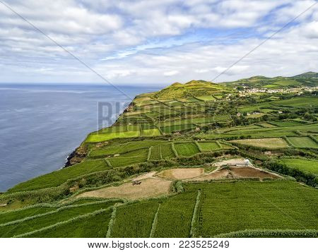 Aerial view of crops and the ocean on the Azorean Island of Sao Miguel in Portugal.