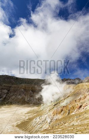 Sulfur water billows from dormant magma tubes at the summit of Mount Egon on East Nusa Tenggara.