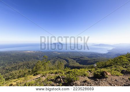 Looking to Pulau Besar island from active Mount Egon on East Nusa Tenggara, Indonesia.