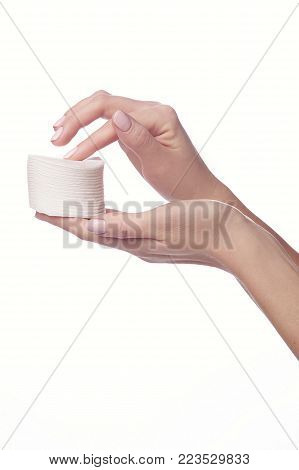 Woman hand and nail varnish remover, acetone isolated on white, clipping path included poster