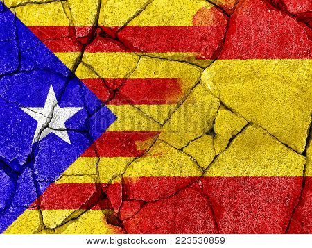 flag of Catalonia on crack cement to communicate the split between Spain and Catalan country
