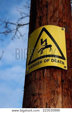 Danger of death warning sign on telegraph pole.