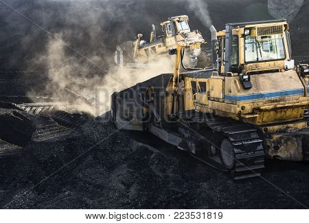 Excavators are working, ecological problem, dirty job