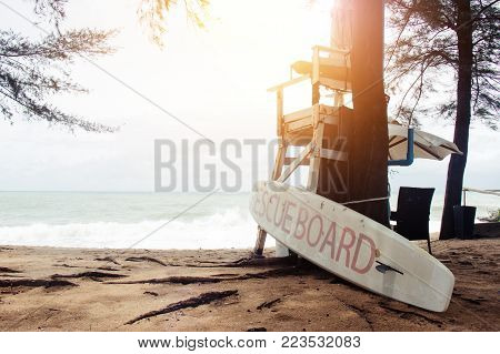 empty lifeguard stand with rescue board on the beach at Phuket , Thailand