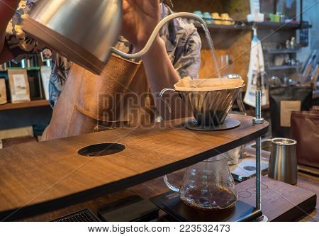 Hand Drip Coffee. Barista Pouring Water From Silver Teapot
