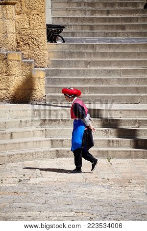 Shangri-La, China - September 25, 2017: Woman walks in the Songzanlin Monastery, built in 1679, is the largest Tibetan Buddhist monastery in Yunnan province, known as Little Potala Palace.
