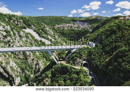 Two mountain tunnel and bridge one over the other,  tilt-shift effect