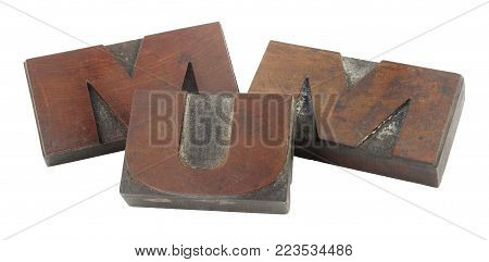 Old wooden printing blocks spelling the word MUM isolated on a white background