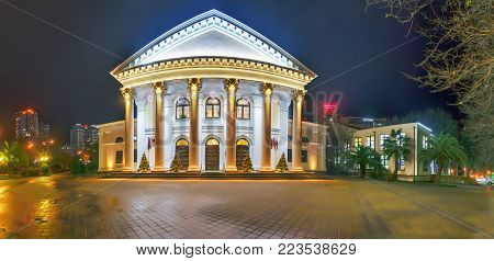 SOCHI, RUSSIA - JANUARY 11, 2018: Glowing building of the old Stereo cinema