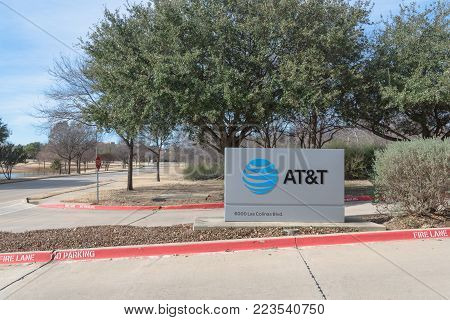 IRVING, TX, US-JAN 20, 2018:Close-up AT T Inc. logo the entrance to Training Campus, AT T Center For Learning. An American multinational conglomerate holding company headquartered at Dallas, Texas