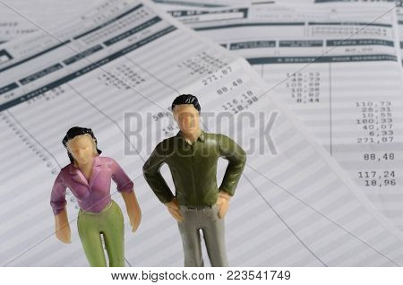 Euro Payroll and woman and man miniature figurine for equal pay illustration
