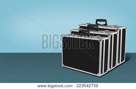 Construction, repair, tools - Three Grey black box case for tools on blue background.