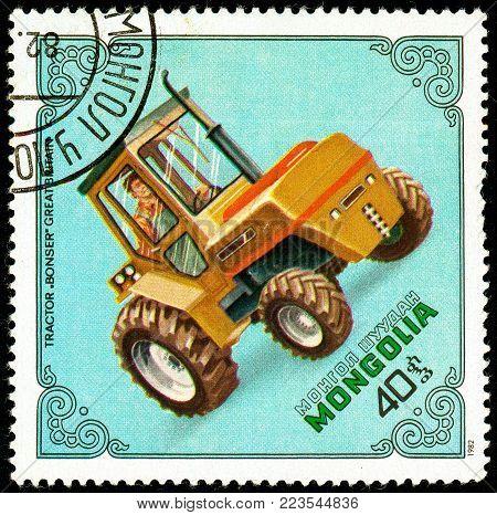 Ukraine - circa 2018: A postage stamp printed in Mongolia show Tractor Bonser, Britain. Series: Tractors. Circa 1982.