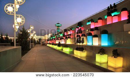 Ashgabat, Turkmenistan - October 14, 2015. Alley with beautiful lights in the evening park. Ashgabat, Turkmenistan - October 14, 2015.