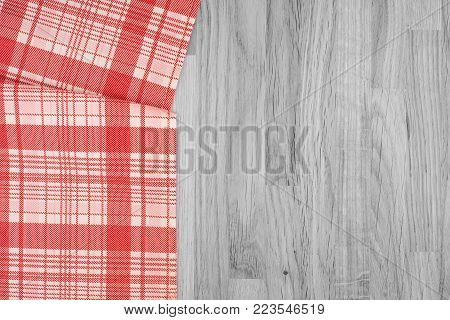 the checkered tablecloth on wooden table. Abstract background, empty template.