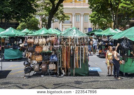 Belo Horizonte, Brazil - Dec 23, 2017: Belts and handbags on display for sale at a street market in Belo Horizonte, Minas Gerais, Brazil