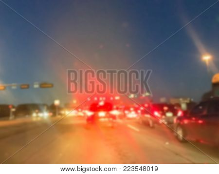 Blurred Long Line Of Cars Waiting At Stop Light At Sunset Irving, Texas, Usa