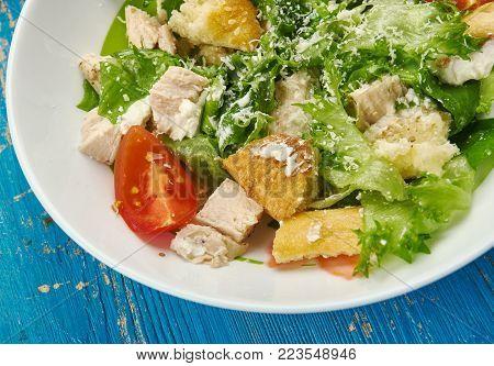 Kale Caesar Salad , salad garlicky greek yogurt  with the croutons and shaved Parmesan.