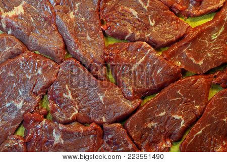 Raw steaks on the table. Top view image.