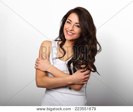 Happy Smiling Beautiful Woman Hugging Herself With Natural Emotional Enjoying Face On White Backgrou