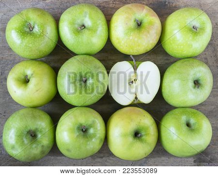 Large group of healthy, green apples on wooden table.