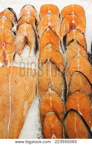 Frozen fish. sale in market. Sea fish on ice. Bunch of raw frozen fish on ice. Red fish