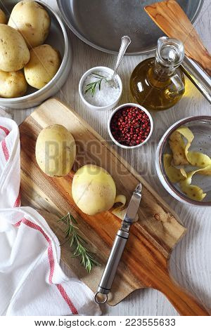 Cooking of fried potatoes,  kitchen-ware and ingredients. Top view