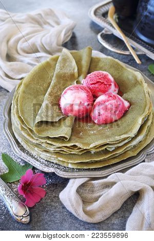Matcha green tea pancakes (blinis) and three balls of fruit ice cream dressing