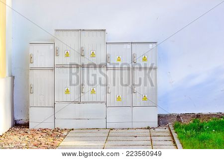 Electro-panel cabinets. Industrial equipment for high voltage electrical supply of civil and industrial objects. White electro-cab in front of a white wall. Bialystok, Poland poster