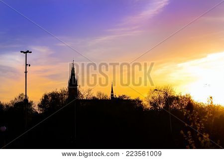 Dark outline of temple against light sky. Cathedral Basilica of Assumption of Blessed Virgin Mary in Bialystok, Poland. Gothic architecture of red brick - religious memorial and place of worship