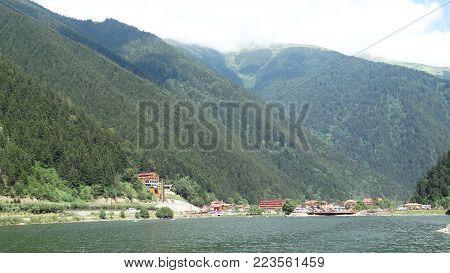 the beauty of cloudy mountains near the lake, trabzon uzungöl muhteşem dağ ve göl manzarası
