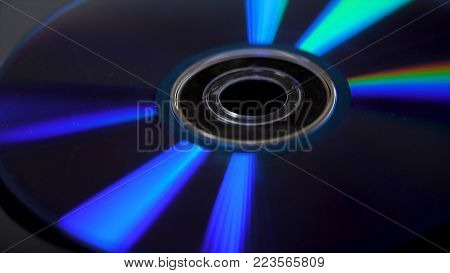 Isolated CD in black background. Colorful abstract background. Close up of CD. DVD Disc on black background - landscape format.
