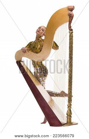 Nude blonde covered by gold tape bodyart with a harp isolated shot on white background