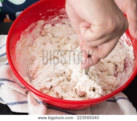 Male Hands Making/ Mixing Dough In Red Bowl, Baking Preparation Closeup.