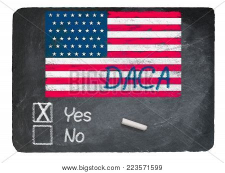 DACA Yes Vote message written in chalk on a chalky natural slate blackboard for current debate over Dreamers