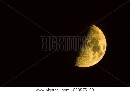 half of yellow moon night of Astro shooting the moon