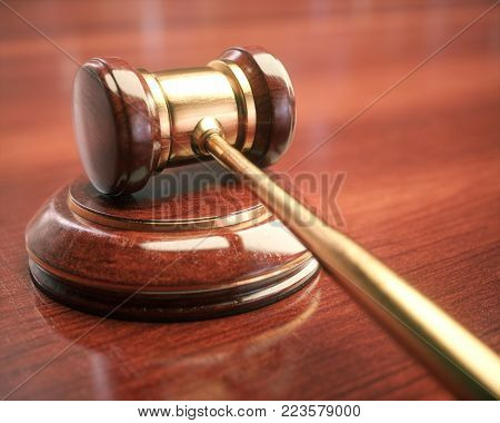 3D illustration. Gavel, judge hammer. Close up of wooden hammer with gold details. Concepts of law and auction.
