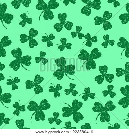 Saint Patricks Day. Vector illustration. Light Green background with a shamrock. Seamless Pattern. Grunge effect, scrapes