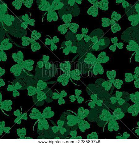Saint Patricks Day. Vector illustration. Black background with a shamrock. Seamless Pattern. Grunge effect, scrapes