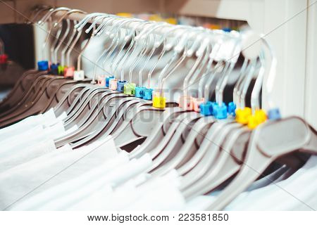 clothes hanger in the store hanging in a row